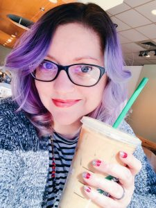 Tara Stoddard wearing glasses holding a Starbucks drink wearing color street nail polish